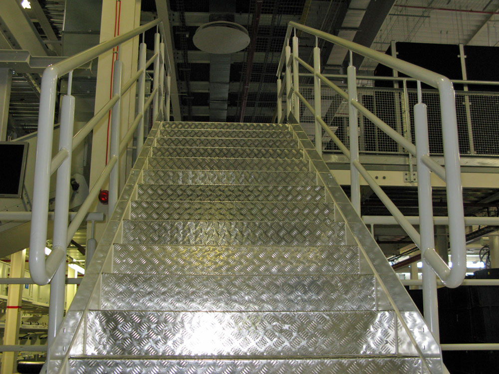 Stainless steel stairs with powder coated protection barrier