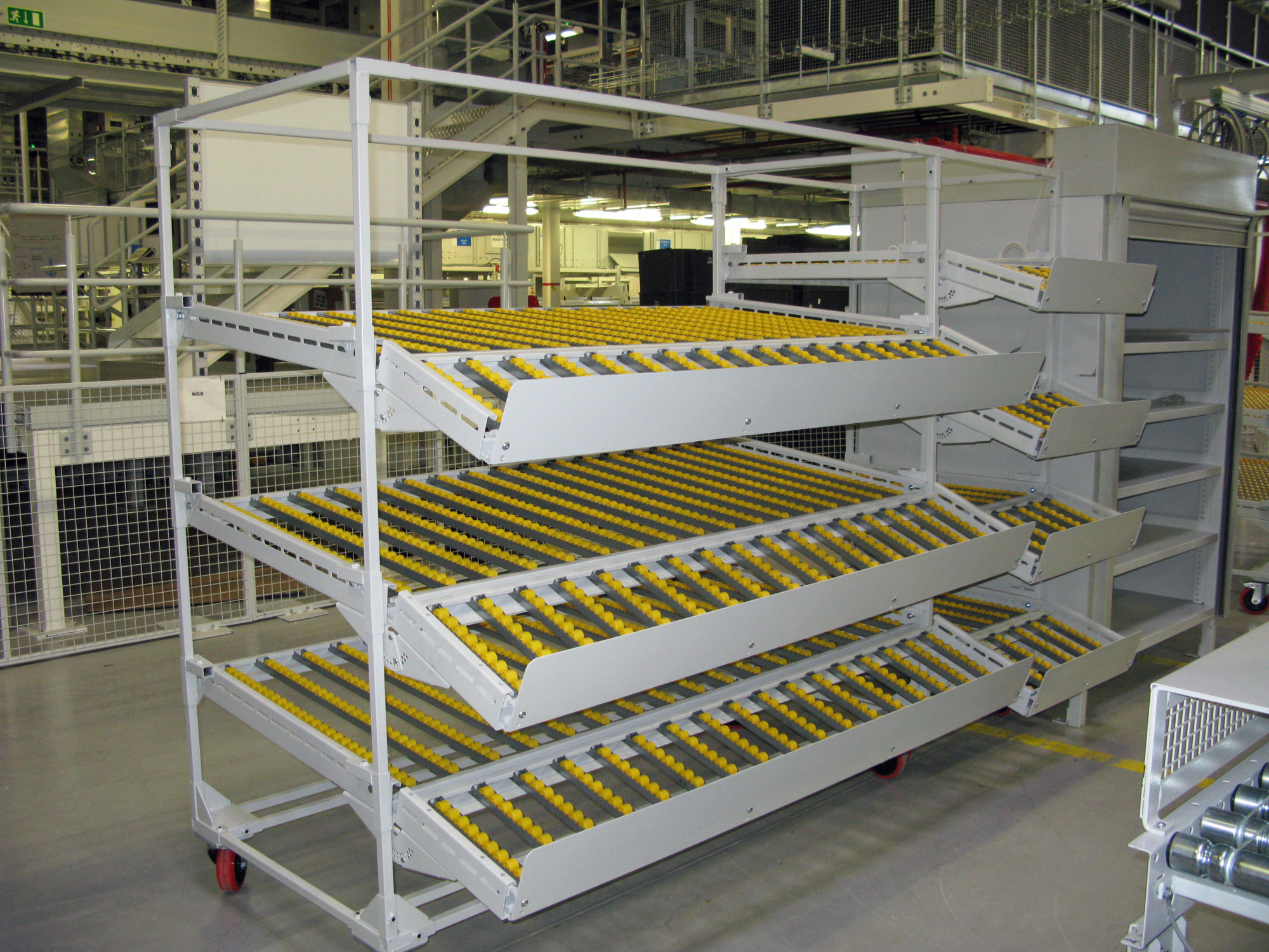 Image showing a trolley with yellow plastic conveyor bearing wheels